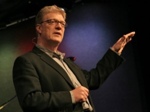 Ken Robinson speaks at a conference.